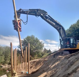 A company choose to mount a MG-90 vibro onto their 2015 John Deere 350G excavator to enhance fisheries habitat for migrating juvenile salmon.
